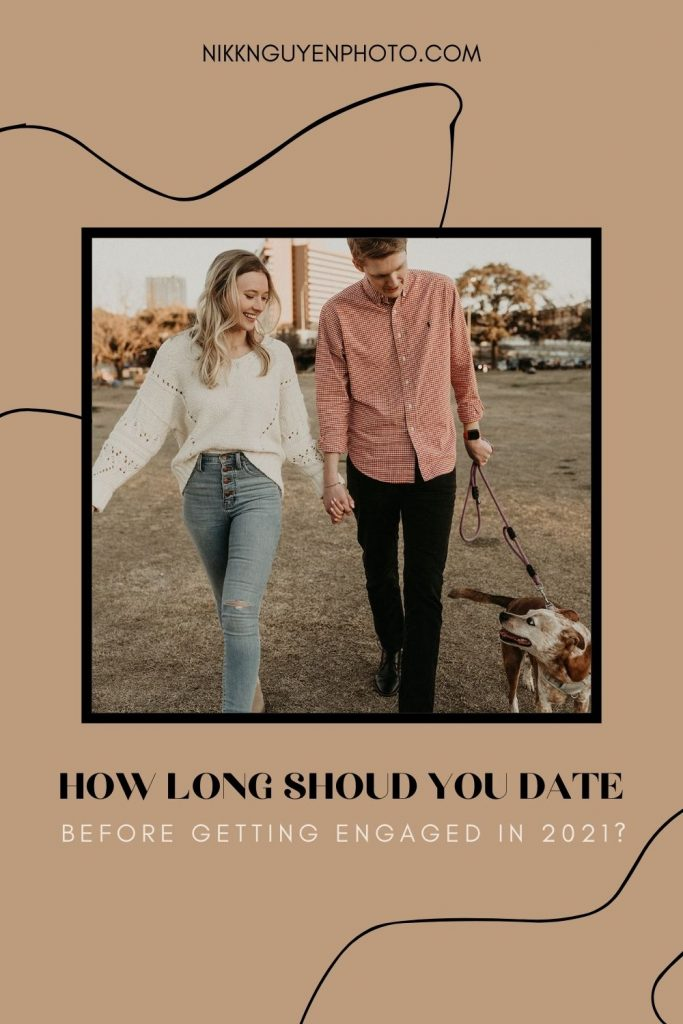 A couple holds hands while walking a dog; image by Nikk Nguyen Photo and overlaid with text that reads How long should you date before getting engaged in 2021?
