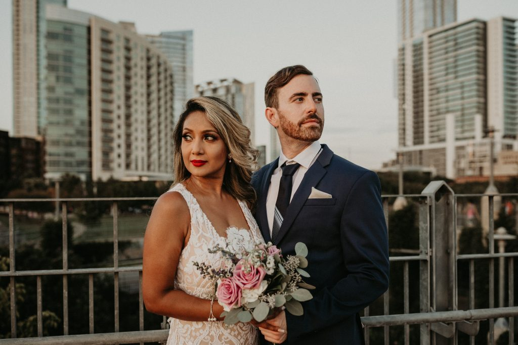 Bride and groom pose for their glamorous couples shoot in Austin photographed by Austin, TX wedding photographer Nikk Nguyen