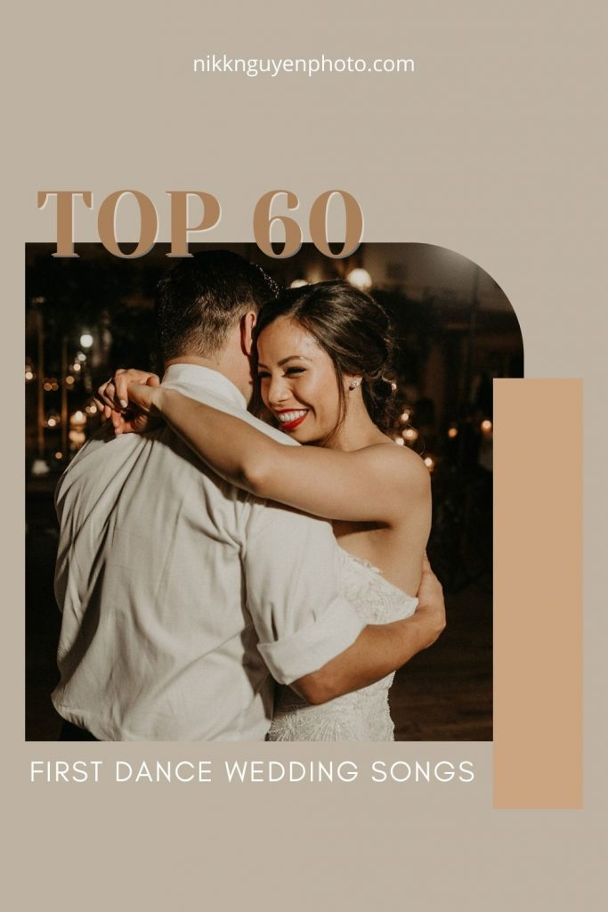 Bride smiles as groom embraces her during their first dance wedding songs taken by Nikk Nguyen; image overlaid with text that reads Top 60 First Dance Wedding Songs