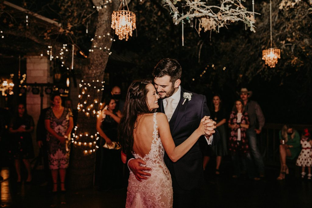 Couple on the dance floor dancing their first wedding dance at the reception, photographed by modern wedding photographer Nikk Nguyen
