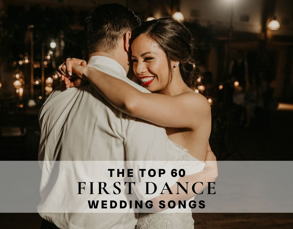 Bride smiles as she embraces groom during their first dance; image overlaid with text that reads The Top 60 First Dance Wedding Songs, photograph by Nikk Nguyen Photo