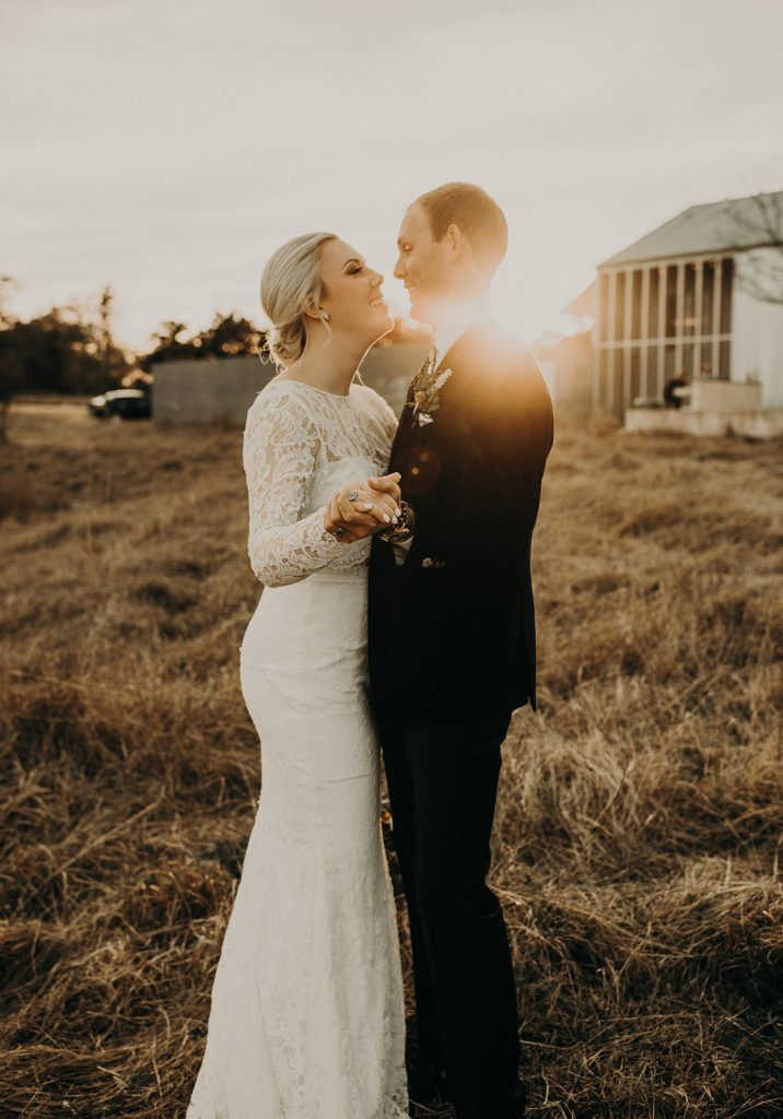 Couple smiling with sunlight coming from behind them, captured by wedding photographer Nikk Nguyen